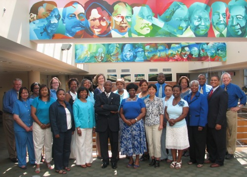 The DORED staff gathers for a group photo with everyone wearing blue to promote Men's Health Month