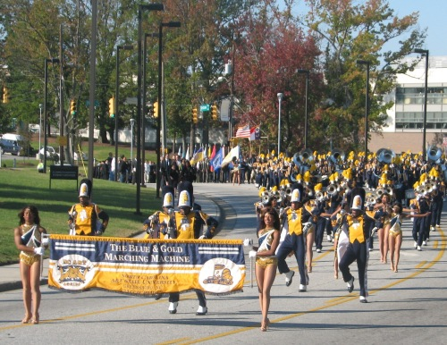 The N.C. A&T Blue and Gold Marching Machine leads the academic procession on its way to Corbett Sports Center.