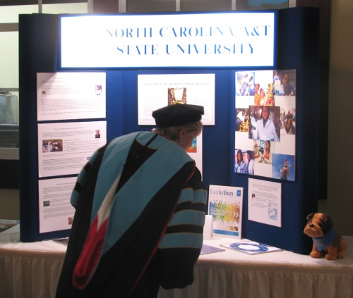 Board of Governors Chair Hanah D. Gage takes a close look at the N.C. A&T research exhibit at the reception following the inauguration.