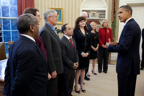Dr. Solomon Bililign and other winners of the presidential award for mentoring meet with President Obama in the Oval Office