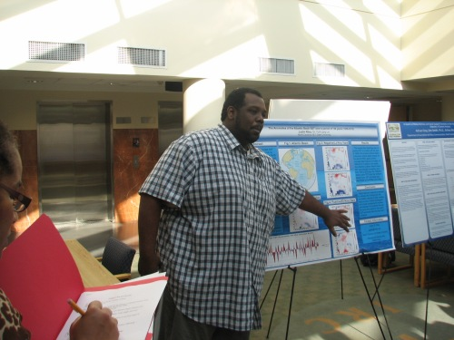 Undergraduate researcher Justin Riley presents his poster.