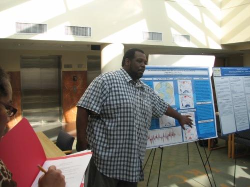 Undergraduate researcher Justin Riley presents his poster.