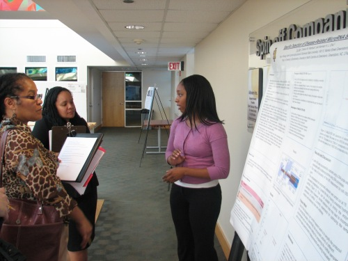 Undergraduate researcher Tia Tate presents her poster.