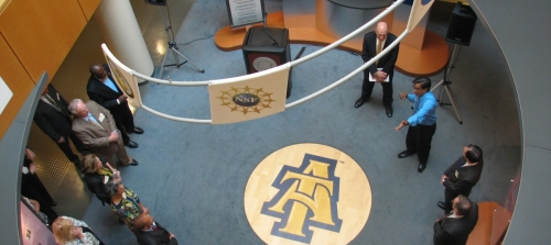 Dr. Jagannathan Sankar speaks to members of the Board of Governors in the atrium of the Fort IRC.