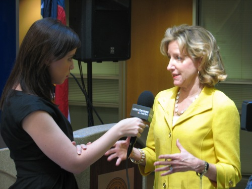 Sen. Hagan explains a point to a reporter