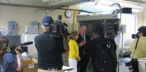 Sen. Hagan and news media photographers in research lab
